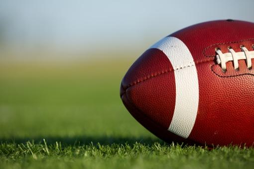 Football on grass turf