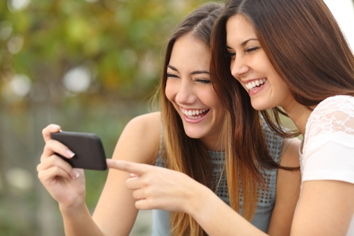 Women watching mobile video on phone