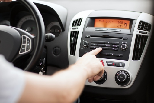 Man in car using FM radio