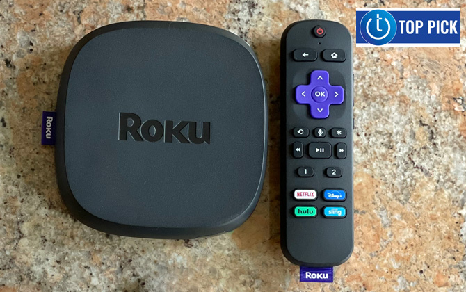 Roku Ultra box and remote sitting on stone counter top. Techlicious Top Pick logo in the upper right.