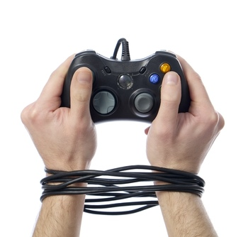 Hands tied by video game controller
