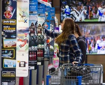 Woman shopping in Walmart's electronics department