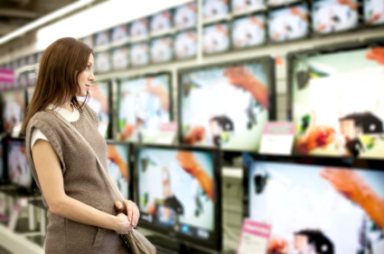 Woman shopping for a tv