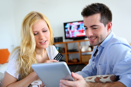 Young couple watching streaming video