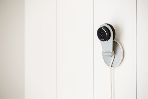 Dropcam HD video camera mounted on a wall