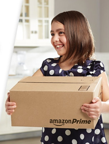 Young girl holding Amazon Prime box