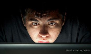 Boy at computer in the dark