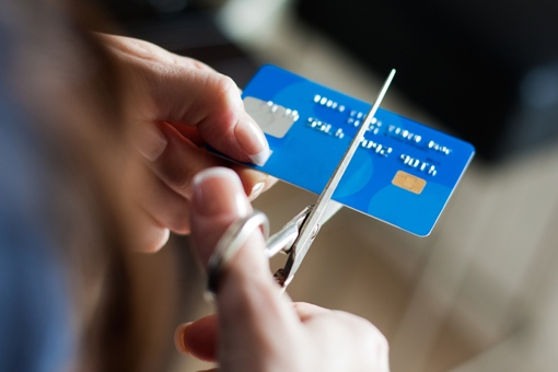 Hand cutting up a credit card