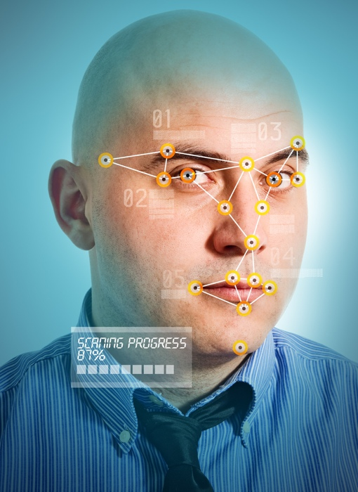 Facial recognition scan of a bald businessman's face