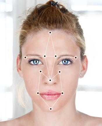 A woman's face being scanned by facial recognition software