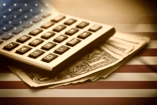 Calculator and money on U.S. flag background