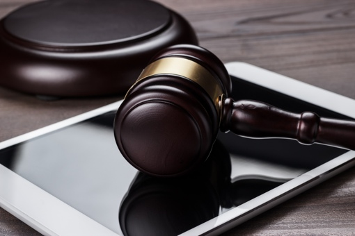 Gavel on tablet computer