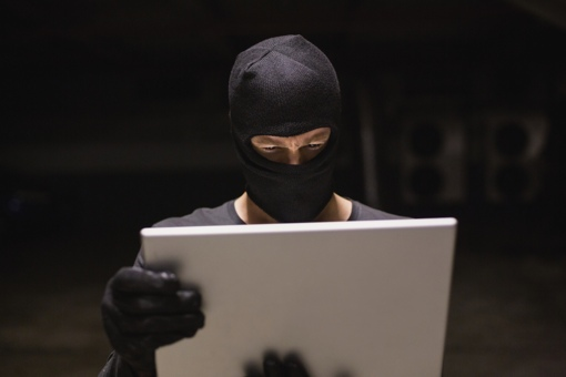 Hacker using a laptop