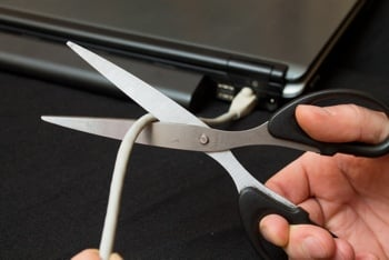 Scissors cutting ethernet cable