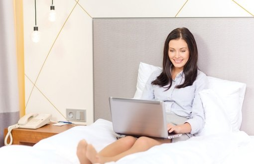 Businesswoman using computer in hotel room