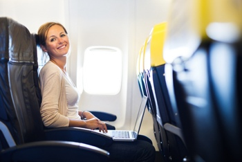Woman using a laptop on a plane