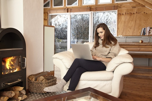 Woman with laptop sitting at home