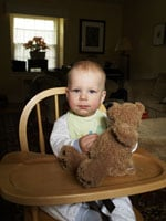 Nick Kelsh photo of baby in highchair