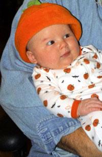 baby in halloween PJs