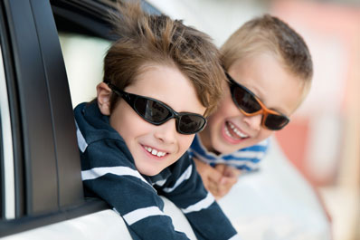 Boys in car - Shutterstock