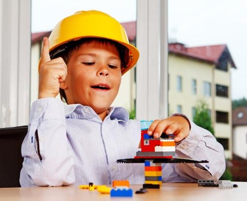 Child building a LEGO set