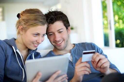 Couple making a purchase online with a tablet