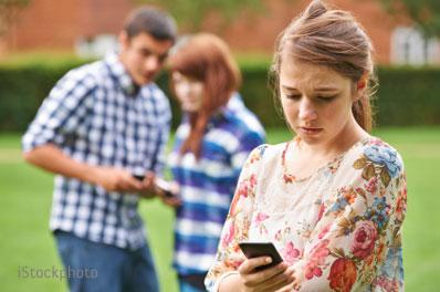Girl being cyberbullied