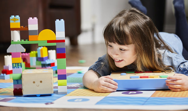 Child playing with coding toy