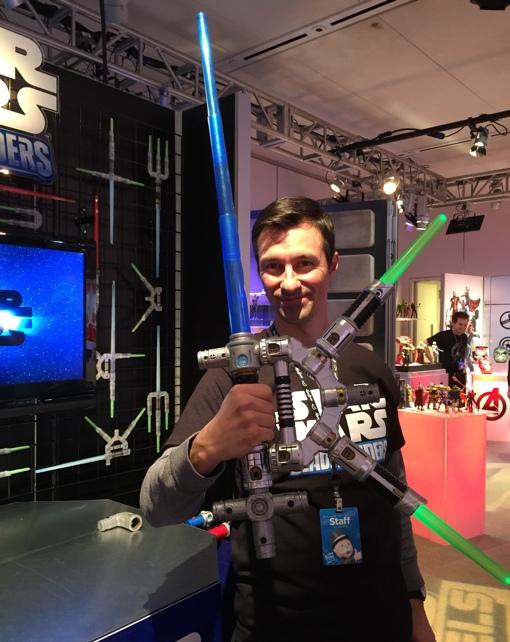Man holding a Star Wars Bladebuilders Lightsaber