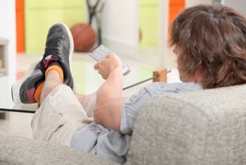 Teenager watching TV