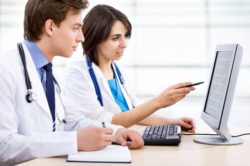 Doctors at a computer
