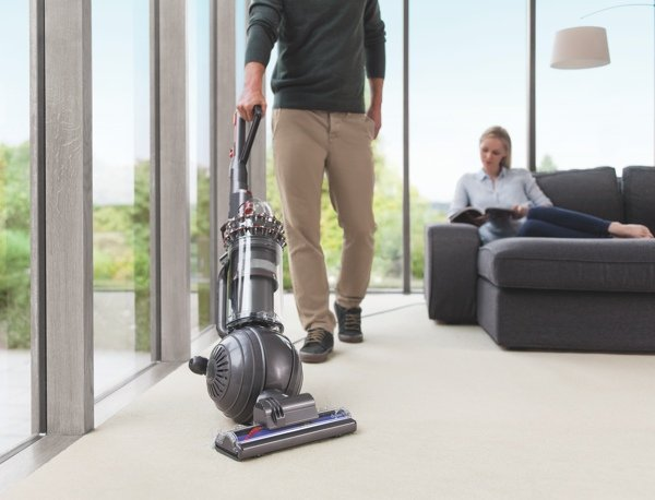 Dyson Cinetic Big Ball upright vacuum being used on carpeting