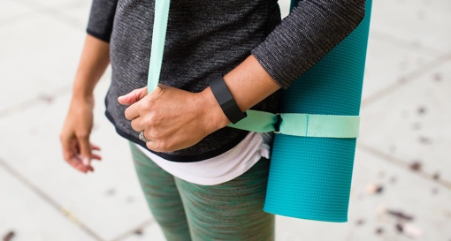 Fitbit Charge worn on a woman's wrist