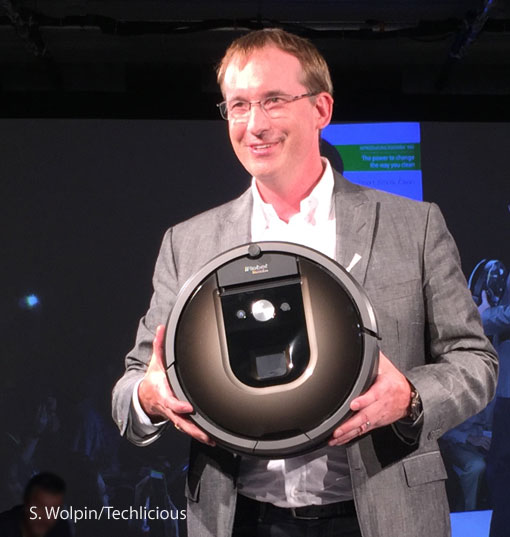 Colin Angle, iRobot co-founder and CEO, with Roomba 980