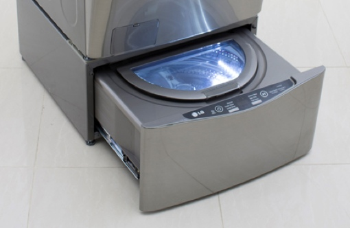 washing machine with sink on top