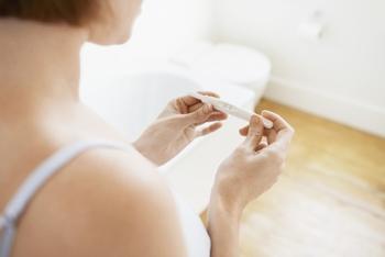Woman checking pregnancy test