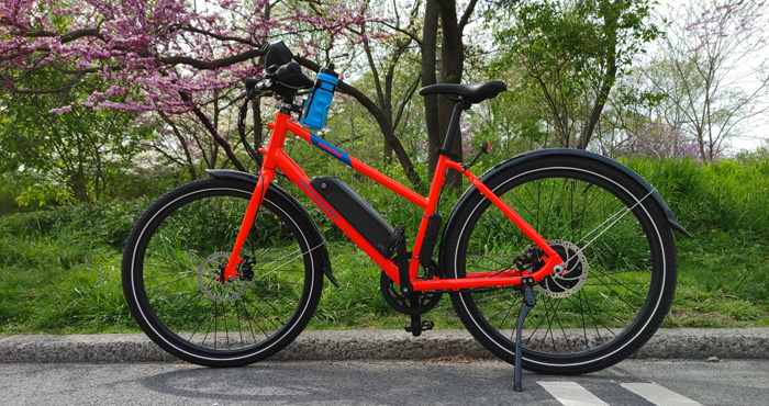 RadMission bike on bike path in Central Park in front of flowering tree in New York City
