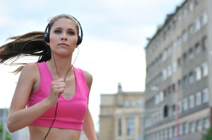 woman running w/ headphones