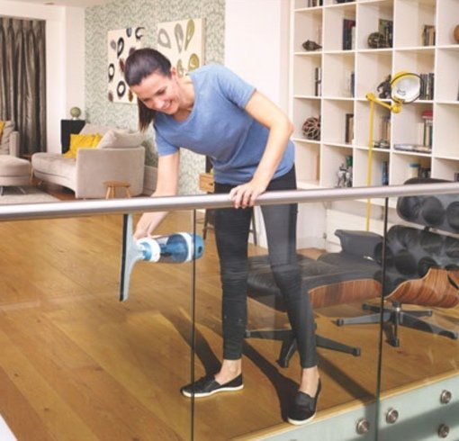 Woman using Black+Decker Powered Squeegee Vac