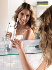 woman with SOnicare toothbrush