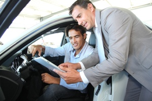 Car salesman and car buyer