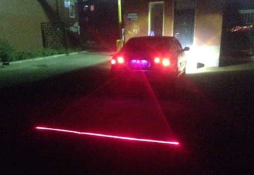 Car with rear-mounted safety laser