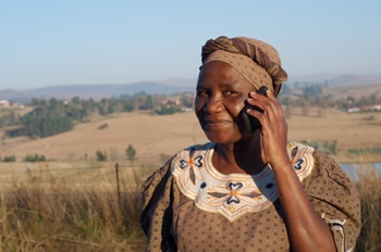 Traditional Zulu woman using a cellphone in Africa