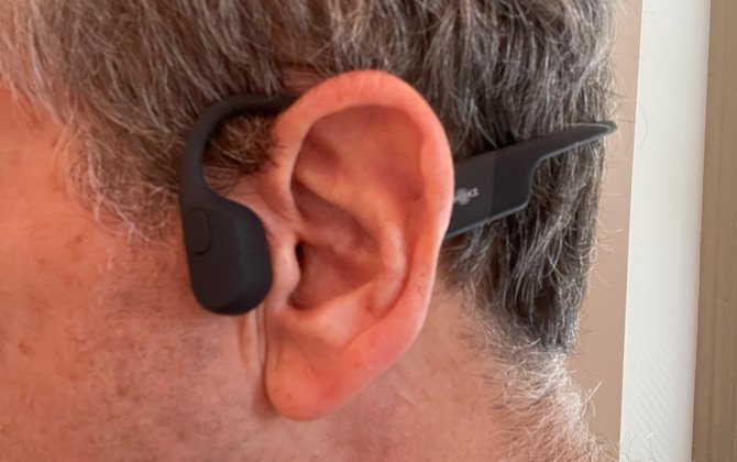 Close-up side view of AfterShokz Aeropex on a model.