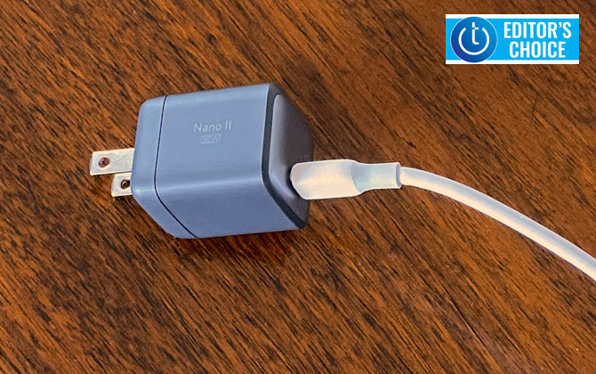 Anker Nano II 30 watt charger shown on table  with USB-C cord plugged in. Techlicious Editor's Choice award logo in upper right.