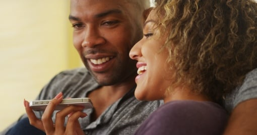 Couple using iPhone voice commands