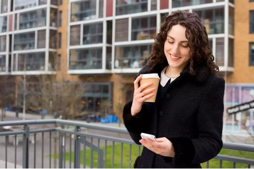 Happy woman on smartphone