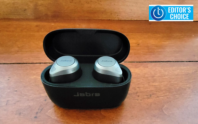 Jabra Elite 85t in carry/charging case on wooden surface. Techlicious Editor's Choice award logo in upper right.