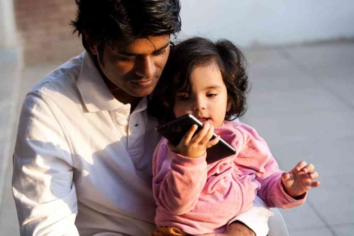 Man and daughter making a phone call
