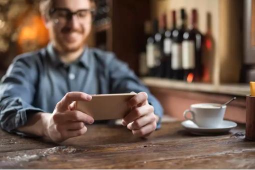Man at restaurant on phone